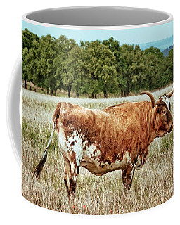 Coffee Mug featuring the photograph A Texas Legend by Linda Unger