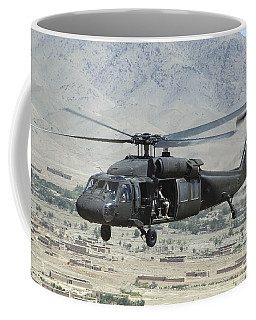 Coffee Mug featuring the photograph A Uh-60 Blackhawk Helicopter by Stocktrek Images