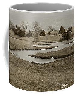 A Winding Creek In Winter As Geese Fly Overhead Coffee Mug