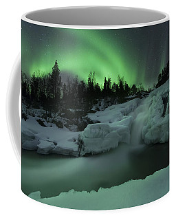 Coffee Mug featuring the photograph A Wintery Waterfall And Aurora Borealis by Arild Heitmann