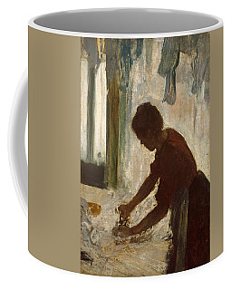 Coffee Mug featuring the painting A Woman Ironing by Edgar Degas