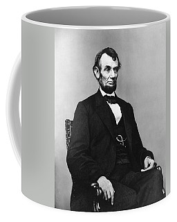 Coffee Mug featuring the photograph Abraham Lincoln Portrait - Used For The Five Dollar Bill - C 1864 by International  Images