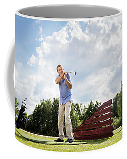Active Senior Man Hitting A Golf Ball. Coffee Mug