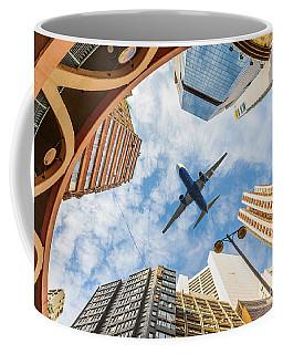 Airplane Above City Coffee Mug