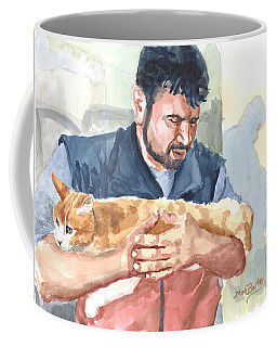 Alaa Rescuing An Injured Cat Coffee Mug