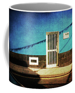 Coffee Mug featuring the photograph Alcala Blue Wall White Door by Anne Kotan