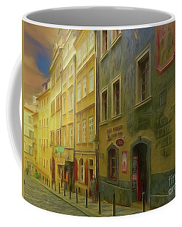 Coffee Mug featuring the photograph All Downhill From Here - Prague Street Scene by Leigh Kemp