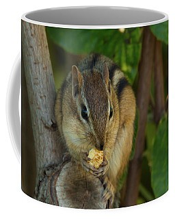 Coffee Mug featuring the photograph Alvin Eating 1 by Brian Hale