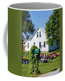 Coffee Mug featuring the photograph Amish House With Mums by Cricket Hackmann