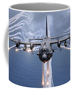 An Ac-130h Gunship Aircraft Jettisons Coffee Mug