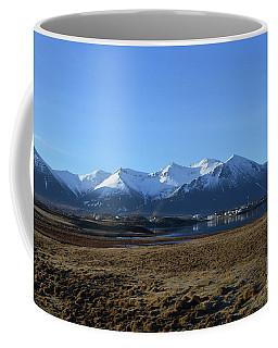 An Icelandic Fishing Village At The Base Of The Rhyolite Mountai Coffee Mug by DejaVu Designs