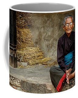 An Old Woman In Bhaktapur Coffee Mug by Valerie Rosen