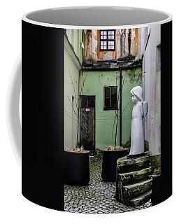 Angel In Courtyard Coffee Mug