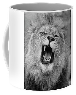 Coffee Mug featuring the photograph Angry Lion by Steve McKinzie