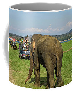 Coffee Mug featuring the photograph Angry Male Elephant Near Safari Jeeps by Patricia Hofmeester
