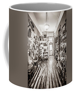 Coffee Mug featuring the photograph Antiques And Old Wood Floor by Marilyn Hunt