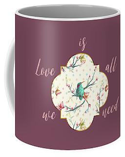 Coffee Mug featuring the digital art Love Is All We Need Typography Hummingbird And Butterflies by Georgeta Blanaru