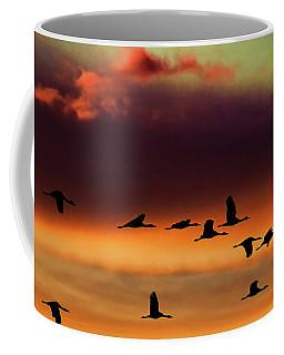 Sandhill Cranes Take The Sunset Flight Coffee Mug
