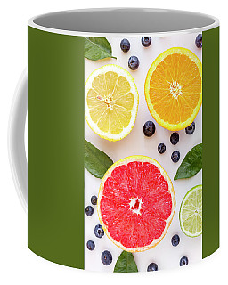 Assortment Of Fresh Citrus Fruits Coffee Mug by Teri Virbickis