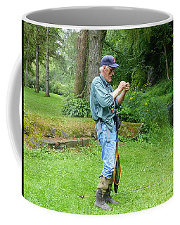 Coffee Mug featuring the photograph Attaching The Lure by Rosanne Licciardi
