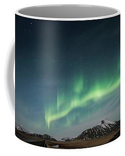 Coffee Mug featuring the photograph Aurora Borealis Over Iceland by Sandra Bronstein