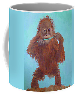 Baby Orangutan Playing Coffee Mug