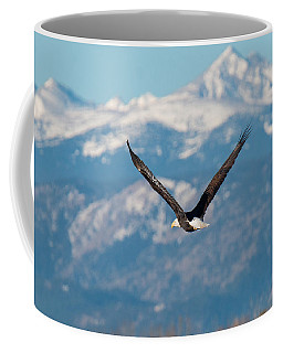 Bald Eagle Soars In Front Of The Rocky Mountains Coffee Mug