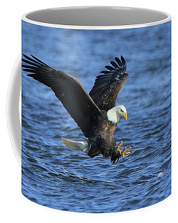 Coffee Mug featuring the photograph Bald Eagle Talons Up by Coby Cooper
