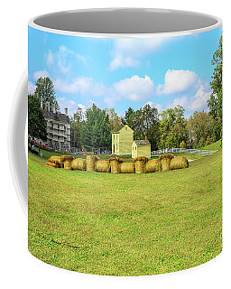 Coffee Mug featuring the photograph Baled Hay In A Grassy Field by Richard J Thompson