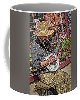 Coffee Mug featuring the photograph Banjo Man Orange by Jim Thompson