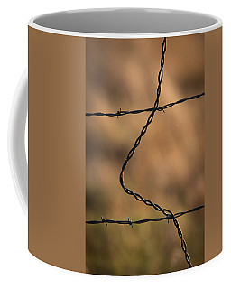 Coffee Mug featuring the photograph Barbed And Bent Fence by Monte Stevens