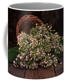 Coffee Mug featuring the photograph Basket Of Fresh Lily Of The Valley Flowers by Jaroslaw Blaminsky