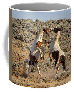 Battle Of Stallions Coffee Mug by Jack Bell