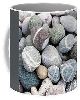 Coffee Mug featuring the photograph Beach Pebbles Close Up by Elena Elisseeva
