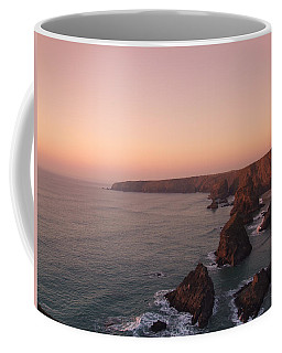 Bedruthan Steps Sunset Coffee Mug by Helen Northcott