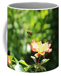 Bee Flying From Peach Petal Rose Coffee Mug