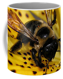 Coffee Mug featuring the photograph Bee On A Lily by William Selander