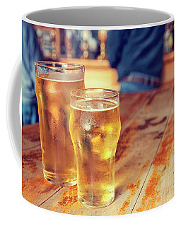 Coffee Mug featuring the photograph Beers In A Pub by Patricia Hofmeester