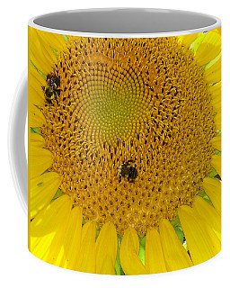 Coffee Mug featuring the photograph Bees Share A Sunflower by Sandi OReilly