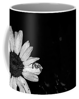Beside Her Coffee Mug