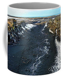 Between Iceland And North America Coffee Mug