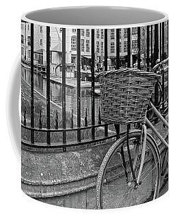 Coffee Mug featuring the photograph Bicycles On Magdalene Bridge Cambridge In Black And White by Gill Billington