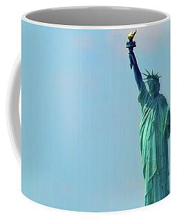 Big Statue, Little Boat Coffee Mug