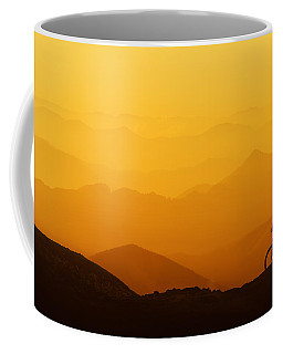Biker Riding On Mountain Silhouettes Background Coffee Mug
