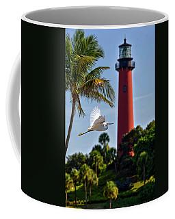 Bird In Flight Under Jupiter Lighthouse, Florida Coffee Mug by Justin Kelefas