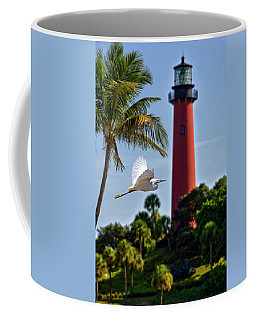 Bird In Flight Under Jupiter Lighthouse, Florida Coffee Mug