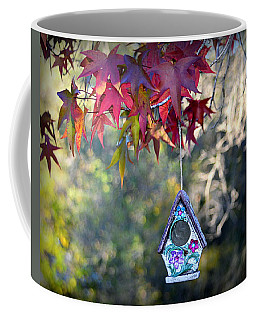 Coffee Mug featuring the photograph Birdhouse Under The Autumn Leaves by AJ Schibig