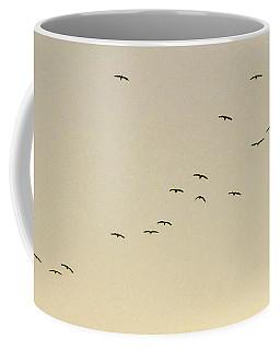 Birds In Flight Over Beige Sunset Sky Coffee Mug