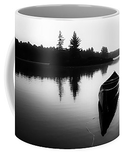 Black And White Canoe In Still Water Coffee Mug