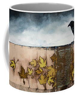 Black Raven Sits Above Scattered Leaves Coffee Mug
